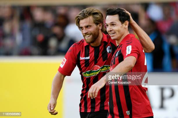 Nicolas Hofler of Sport-Club Freiburg celebrates with teammate Lucas Holer after scoring his team's first goal during the Bundesliga match between...