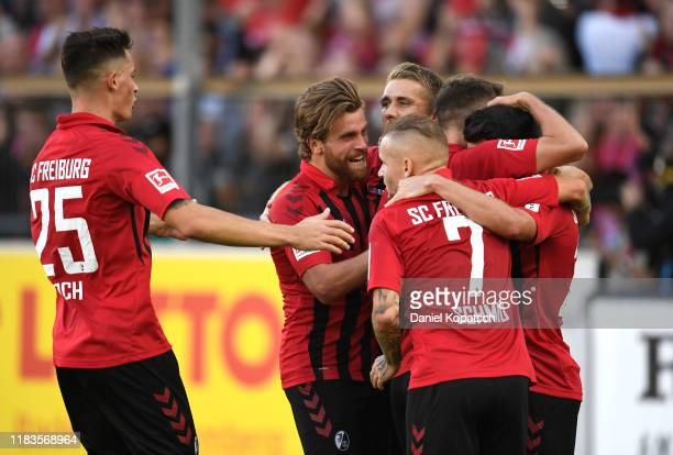 Nicolas Hofler of Sport-Club Freiburg celebrates with teammates after scoring his team's first goal during the Bundesliga match between Sport-Club...