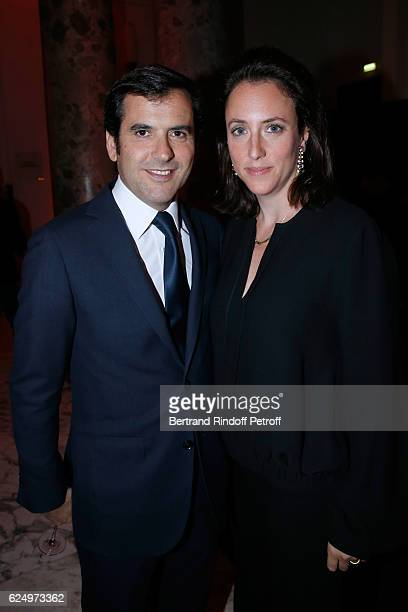 Nicolas Houze and his wife AnneCharlotte attend the Diner des amis de Care for the 70th anniversary of the Association Held at Espace Cambon on...