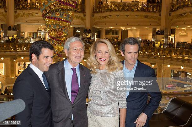 Nicolas Houze Philippe Houze Jerry Hall and Guillaume Houze attend the Galeries Lafayette Christmas Decorations Inauguration In Paris at Galeries...