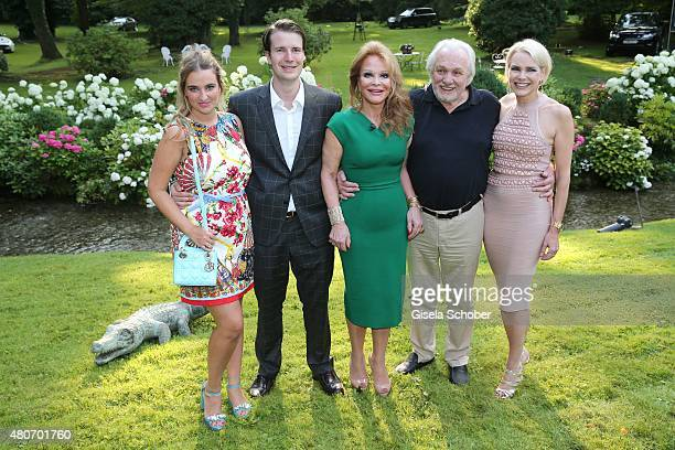 Nicolas Huebner and his girlfriend Stephanie Hackenjos the pink macaron Ulrike Huebner and her husband Erich Kaub and daughter Sabina during the...