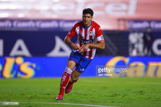Nicolas Ibañez of San Luis celebrates after scoring the first goal of his team during the 6th round match between Atletico San Luis and Cruz Azul as...
