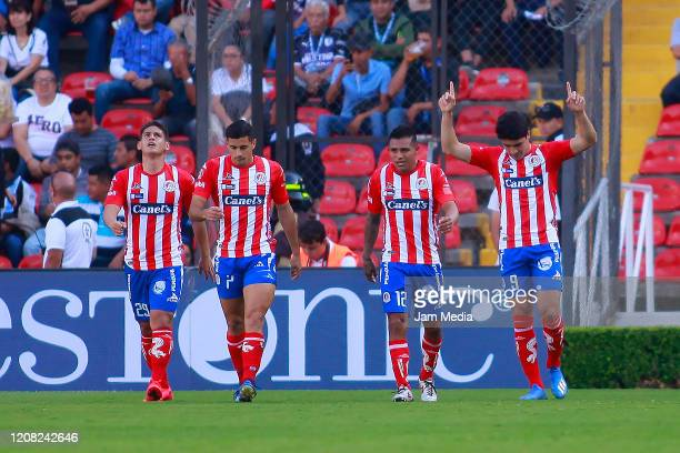 Nicolas Ibañez of San Luis celebrates with teammates after scoring the first goal of his team during the 7th round match between Queretaro and...