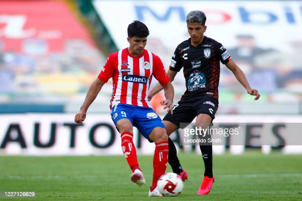 Nicolas Ibanez of Atletico San Luis struggles for the ball with Kevin Nahin Alvarez of Pachuca during a match between Pachuca and Atletico San Luis...