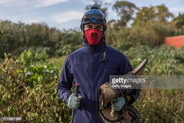 Nicolas Ibarra poses after the training races during a competition day as Uruguay slowly returns to normal due to coronavirus outbreak at Maroñas...