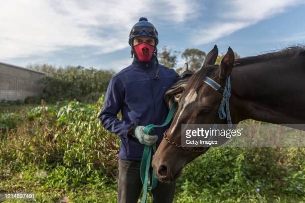 Nicolas Ibarra poses with his horse after the training races during a competition day as Uruguay slowly returns to normal due to coronavirus outbreak...