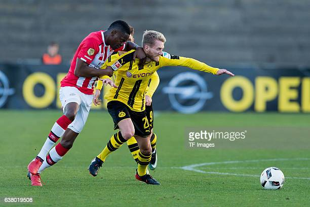 Nicolas Isimat-Mirin of Eindhoven and Andre Schuerrle of Dortmund battle for the ball during the friendly match between Borussia Dortmund v PSV...