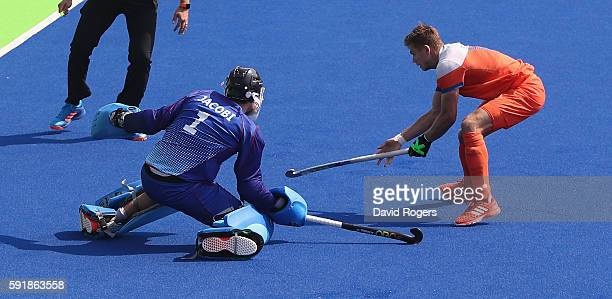 Nicolas Jacobi the Germany goalkeeper saves the shot from Sander de Wijn to win the penalty shoot out during the Men's Bronze Medal match between the...
