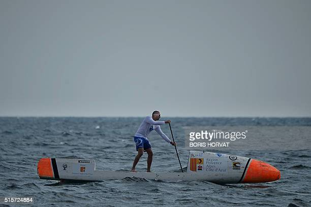 Nicolas Jarossay practices on his Stand Up Paddel on March 15 2016 off Martigues as part of a training session ahead of his attempt to cross the...