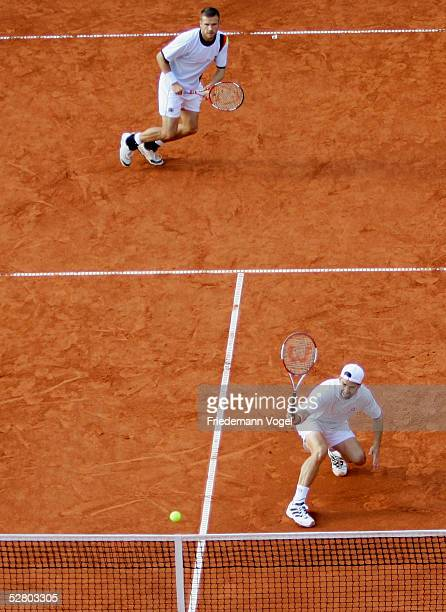 Nicolas Kiefer and Alexander Waske of Germany in action during their doubles match against Michael Llondra and Fabrice Santoro of Frace during the...
