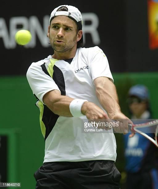 Nicolas Kiefer defeats Juan Ignacio Chela 76 63 63 to move into the quarterfinal at the Australian Open Melbourne Australia