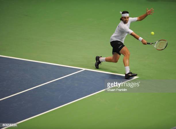 Nicolas Kiefer of Germany in action during his match against Feliciano Lopez of Spain during Davis Cup World Group quarter final match between...