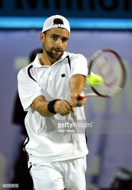 Nicolas Kiefer of Germany plays a backhand during his victory over Hyung-Taik Lee in their second round match in the Dubai Duty Free Men's Open...