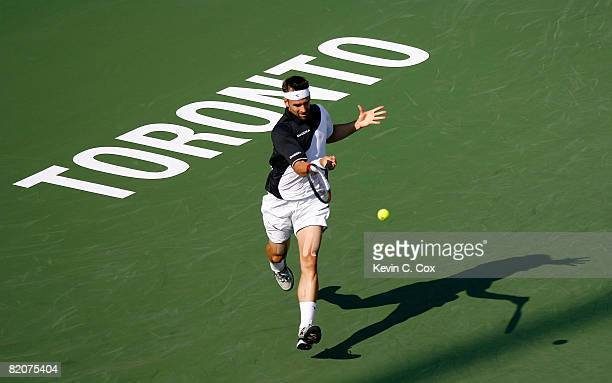 Nicolas Kiefer of Germany returns a shot to Gilles Simon of France during the Rogers Cup at the Rexall Centre at York University on July 26 2008 in...