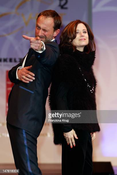 Nicolas Koenig and Inka Friedrich show designs on the catwalk during the charity event 'Event Prominent' at the Hotel Grand Elysee on March 25 2012...