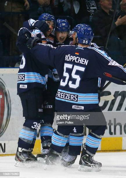 Nicolas Kraemmer of Hamburg celebrates with his team mates after scoring his team's second goal during the DEL match between Hamburg Freezers and...