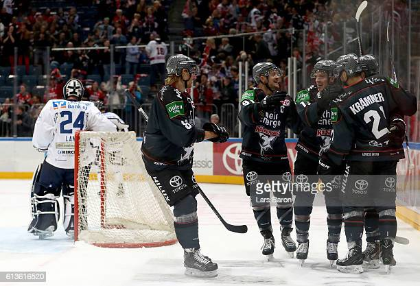 Nicolas Kraemmer of Koeln celebrates with team mates after scoring his teams second goal during the DEL match between Koelner Haie and Iserlohn...