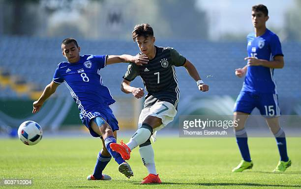Nicolas Kuehn of Germany and Ilay Elmkies of Israel vie for the ball during the Under 17 four nations tournament match between U17 Germany and U17...