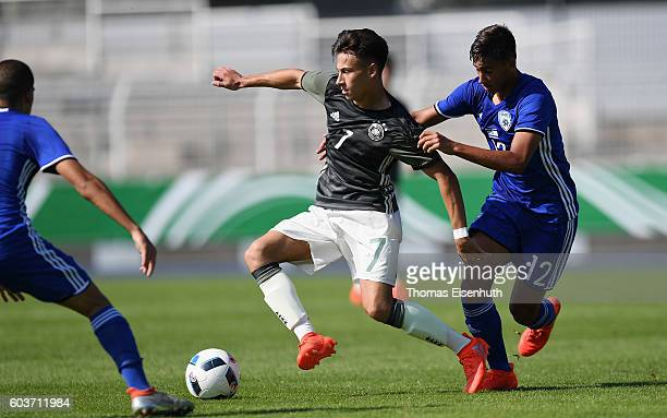 Nicolas Kuehn of Germany and Tomer Mahluf of Israel vie for the ball during the Under 17 four nations tournament match between U17 Germany and U17...