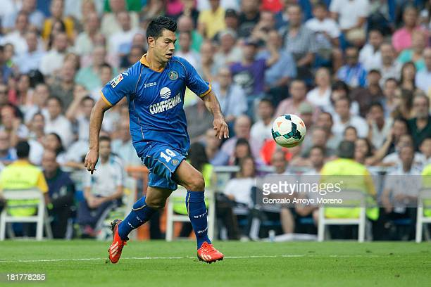 Nicolas Ladislao alias Miku of Getafe CF runs for the ball during the La Liga match between Real Madrid CF and Getafe CF at Estadio Santiago Bernabeu...