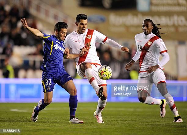 Nicolas Ladislao Miku of Rayo Vallecano de Madrid is tackled by Emiliano Buendia ''Emi'' of Getafe during the La Liga match between Rayo Vallecano...