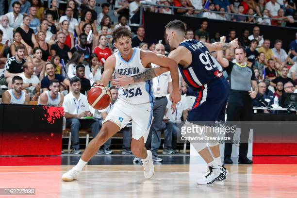 Nicolas Laprovitolla of Argentina drives to the basket against Paul Lacombe of France during the International Friendly match between France and...