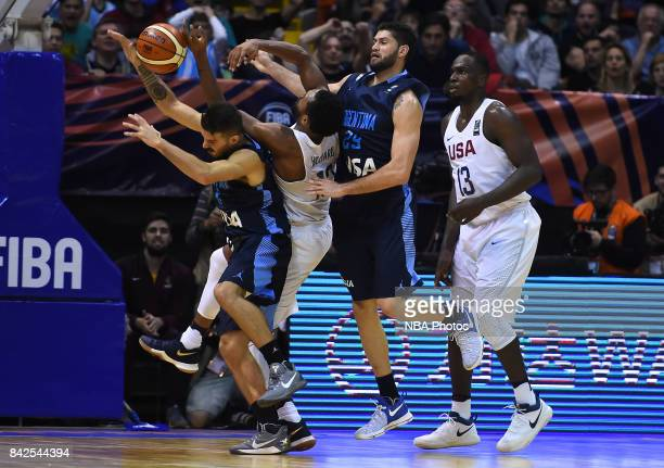 Nicolas Laprovittola and Patricio Garino of Argentina fight for ball with Darrun Hilliard II and Jameel Warney of United States during the FIBA...