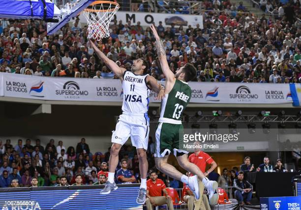 Nicolas Laprovittola of Argentina goes to the basket over Alex Perez of Mexico during a match between Argentina and Mexico as part of FIBA Americas...