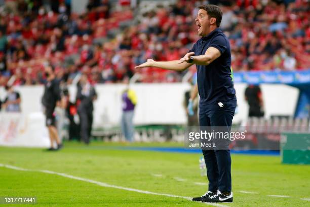Nicolas Larcamon, Head Coach of Puebla reacts during the quarterfinals first leg match between Atlas and Puebla as part of the Torneo Guard1anes 2021...