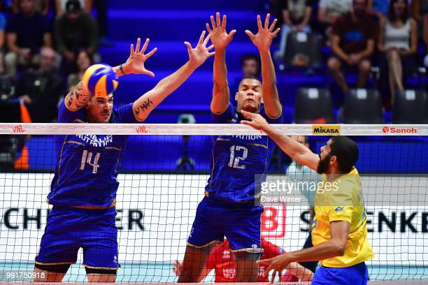 Nicolas Le Goff of France Stephen Boyer of France and Wallace De Souza of Brasil during the Volleyball Nations League match between France and Brasil...