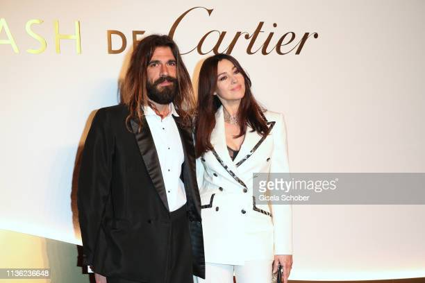 Nicolas Lefebvre and Monica Bellucci during the Clash de Cartier event at la Conciergerie on April 10 2019 in Paris France