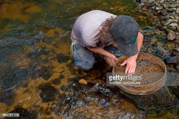 Nicolas Leger an amateur gemologist looks for sapphires in a river in Issoire on May 27 2017 The subsoil of the Auvergne region is saturated with...