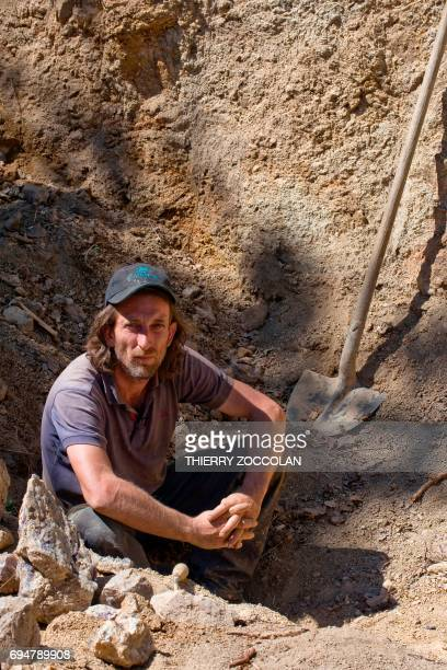 Nicolas Leger an amateur gemologist poses as he looks for amethysts on May 27 2017 in VernetlaVarenne PHOTO / Thierry Zoccolan