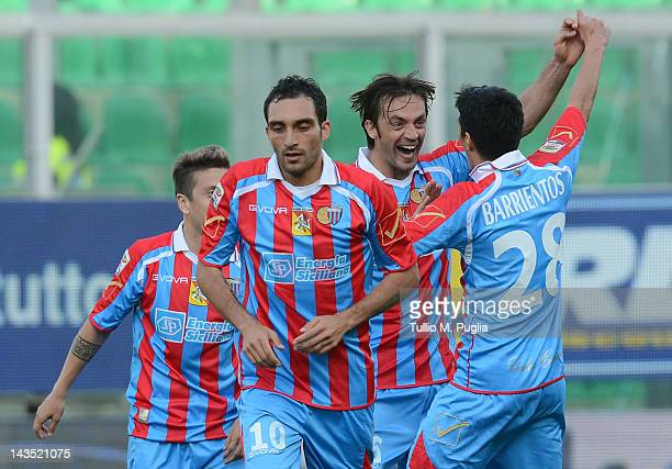 Nicolas Legrottaglie of Catania celebrates with team-mates after scoring the opening goal during the Serie A match between US Citta di Palermo and...