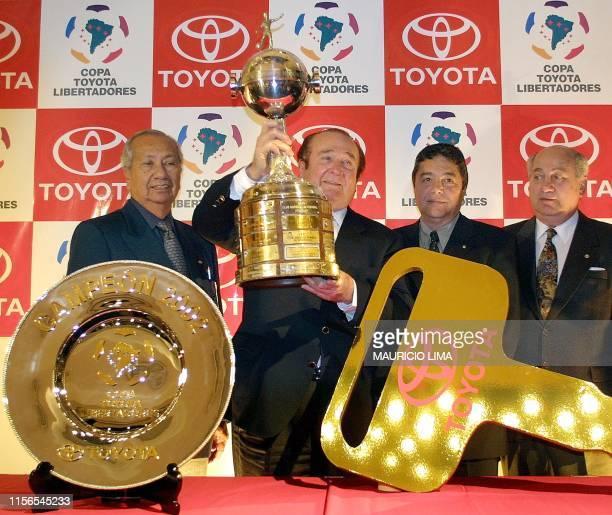 Nicolas Leoz President of the South American Soccer Federation presents 20 July 2002 the Champion cup Libertadores de la America in Sao Paulo Brazil...