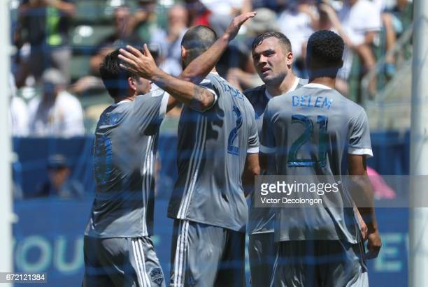 Nicolas Lodeiro Clint Dempsey Jordan Morris and Jordy Delem of Seattle Sounders celebrate after a goal scored by Dempsey during the first half of...