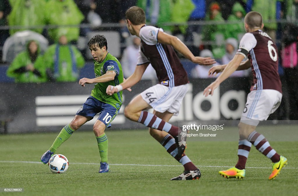 Nicolas Lodeiro #10, left, of the Seattle Sounders dribbles the ball in front of Axel Sjoberg #44, center, of the Colorado Rapids and Sam Cronin #6 of the Colorado Rapids during the second half of a match in the first leg of the Western Conference Finals at CenturyLink Field on November 22, 2016 in Seattle, Washington. The Sounders won the match 2-1.
