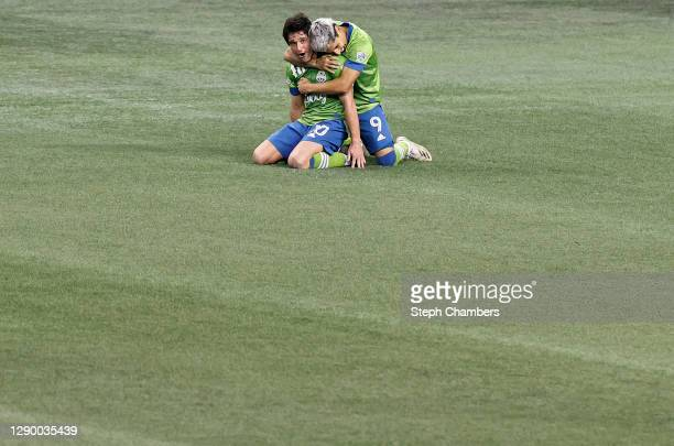 Nicolas Lodeiro of Seattle Sounders and Raul Ruidiaz embrace after their 3-2 win against the Minnesota United during the Western Conference Final of...
