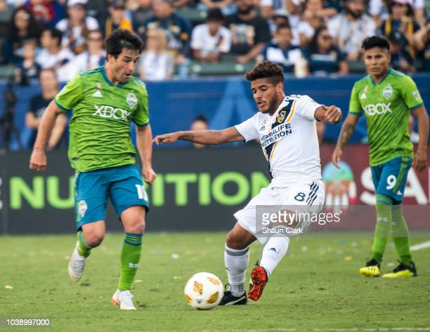 Nicolas Lodeiro of Seattle Sounders battles Jonathan dos Santos of Los Angeles Galaxy during the Los Angeles Galaxy's MLS match against Seattle...