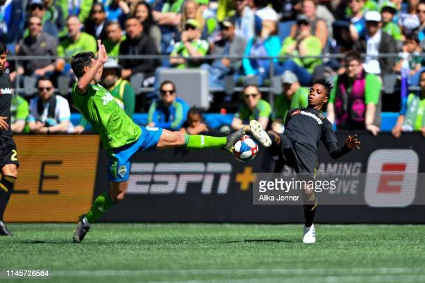 Nicolas Lodeiro of the Seattle Sounders and Latif Blessing of the Los Angeles FC battle for possession of the ball during the second half of the...