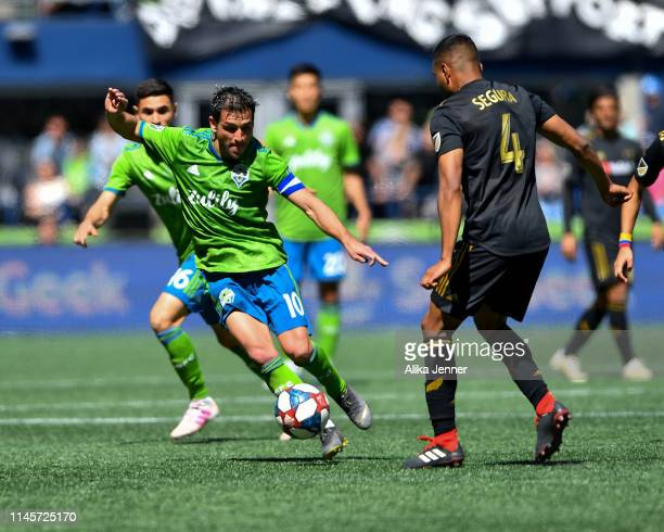 Nicolas Lodeiro of the Seattle Sounders makes a move on Eddie Segura of the Los Angeles FC during the second half of the match at CenturyLink Field...
