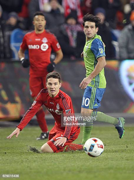 Nicolas Lodeiro of the Seattle Sounders trips up Will Johnson of the Toronto FC during the 2016 MLS Cup at BMO Field on December 10 2016 in Toronto...