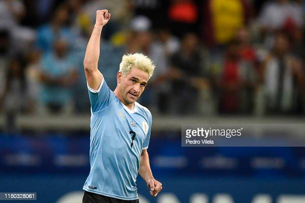 Nicolas Lodeiro of Uruguay celebrates after scoring the first goal of his team during a match between Uruguay and Ecuador at Mineirao Stadium on June...