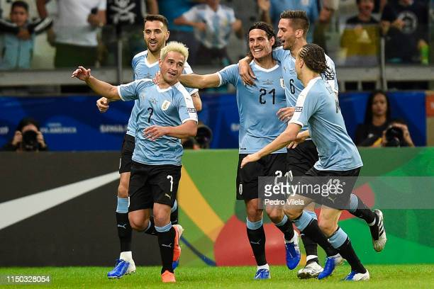 Nicolas Lodeiro of Uruguay celebrates with teammate Edinson Cavani after scoring the first goal of his team during a match between Uruguay and...