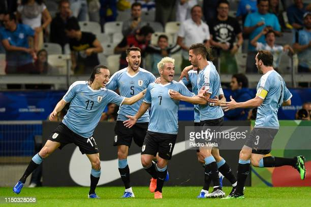 Nicolas Lodeiro of Uruguay celebrates with teammates after scoring the first goal of his team during a match between Uruguay and Ecuador at Mineirao...