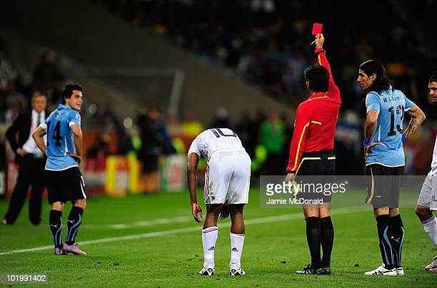 Nicolas Lodeiro of Uruguay is shown a red card by Referee Yuichi Nishimura during the 2010 FIFA World Cup South Africa Group A match between Uruguay...