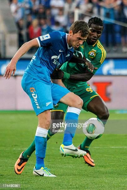 Nicolas Lombaerts of FC Zenit St. Petersburg and Ibrahima Balde of FC Kuban Krasnodar vie for the ball during the Russian Premier League match...