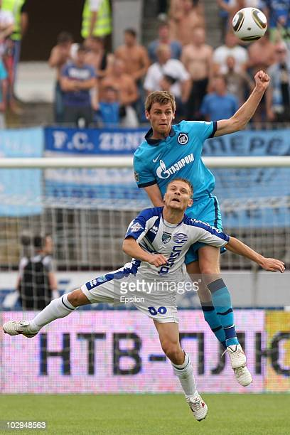 Nicolas Lombaerts of FC Zenit St Petersburg competes for the ball in the air with Maksim Astafyev of FC Sibir Novosibirsk during the Russian Football...
