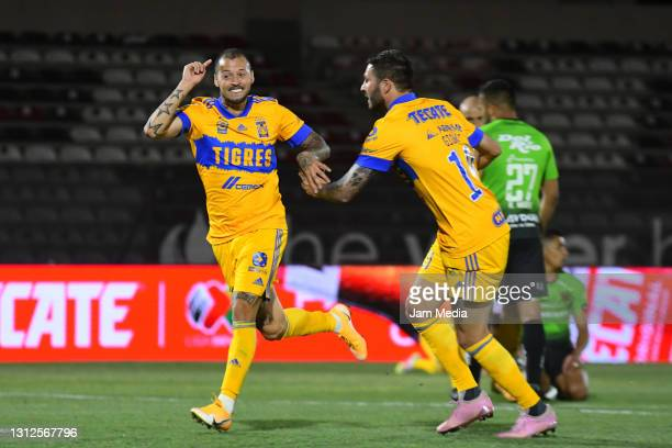 Nicolas Lopez of Tigres celebrates with teammates after scoring the first goal of his team during a match between FC Juarez and Tigres UANL at...