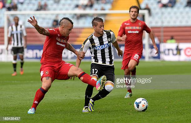 Nicolas Lopez of Udinese competes with Radja Nainggolan of Cagliari during the Serie A match between Udinese Calcio and Cagliari Calcio at Stadio...